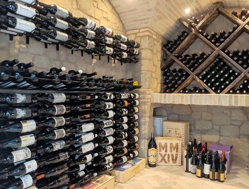 Beautiful Transitional Cellar with Stone Detailing