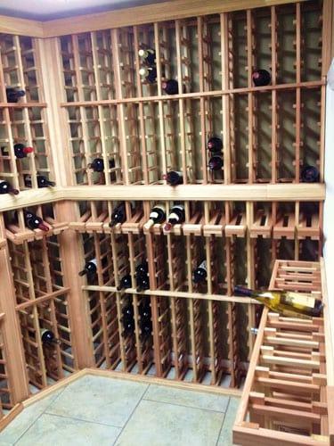Custom wine cellar with kit based wine racks for Home wine cellar kits
