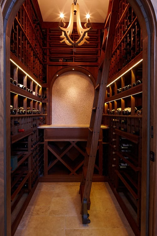 Dedicated wine room for a high end customized home for Wine cellar in house