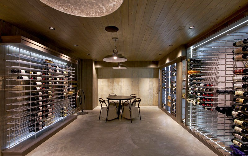 Dramatic glass enclosed wine room