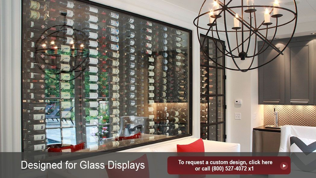 Glass enclosed modern wine cellar design. Thousands of serious wine collectors choose IWA for their custom designs.